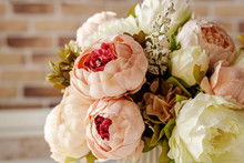 Artificial Flowers On Brick W...