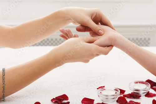 Hand massage closeup, acupressure Canvas Print