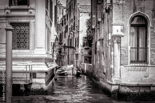 Staande foto Praag Narrow side street with a boat at Grand Canal, Venice
