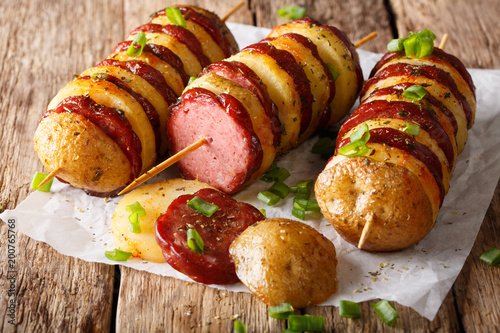 Türaufkleber Grill / Barbecue Barbecue potato skewers with sausage salami and green onion close-up. horizontal