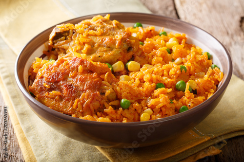 Brazilian Galinhada chicken and rice with peas and corn close-up. horizontal