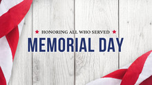 Memorial Day - Honoring All Who Served Text Over White Wood Wall Texture Background And American Flags