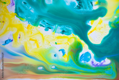 Fluid art acrylic party background. Cosmic music poster. Creative artwork hippie wallpaper in yellow