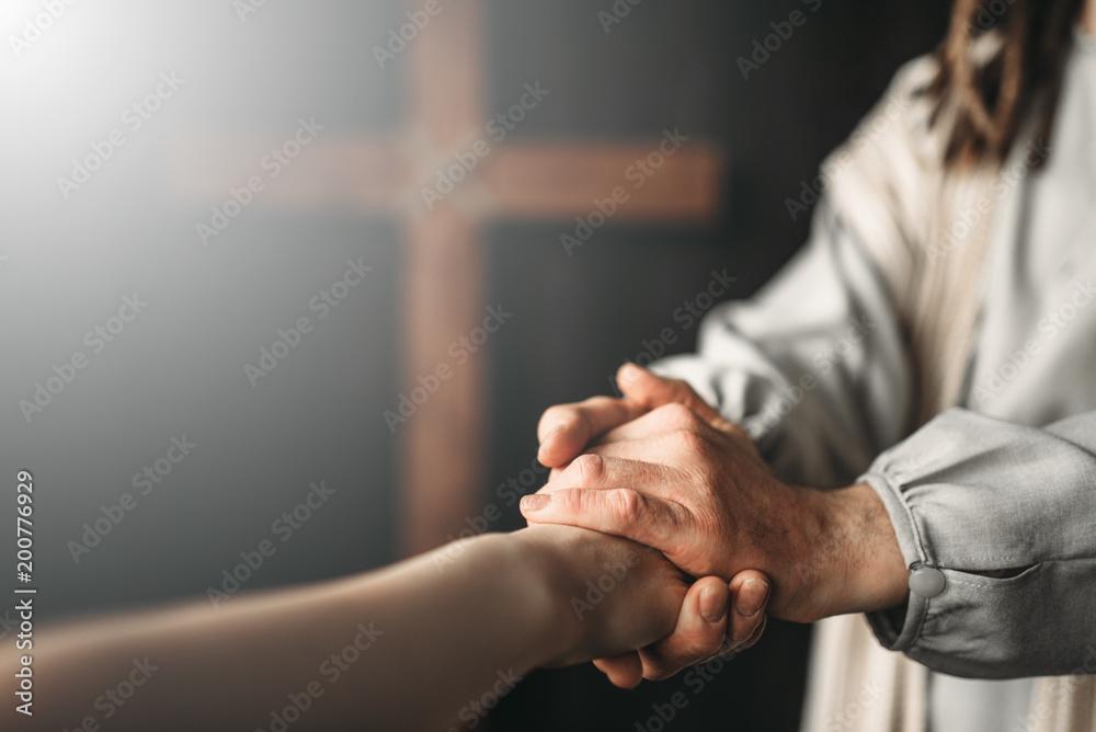 Fototapeta Jesus Christ gives a helping hand to the faithful