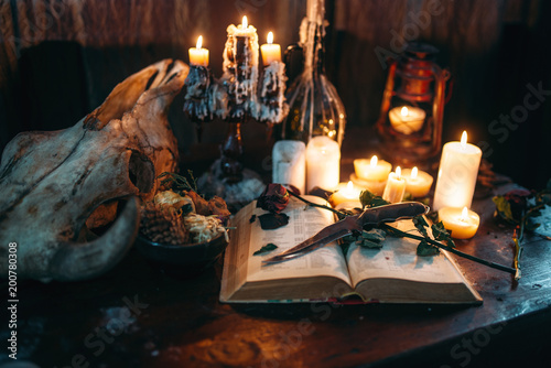 Foto op Canvas Mediterraans Europa Witchcraft, dark magic, candles with ritual book