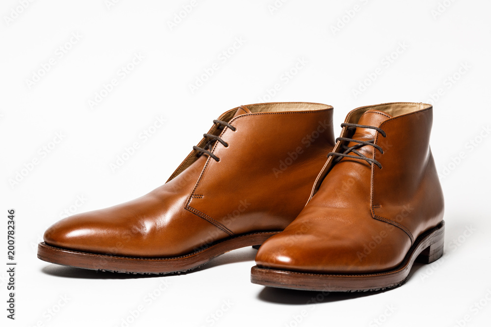 Fototapeta Men's classic brown leather shoes isolated on white background