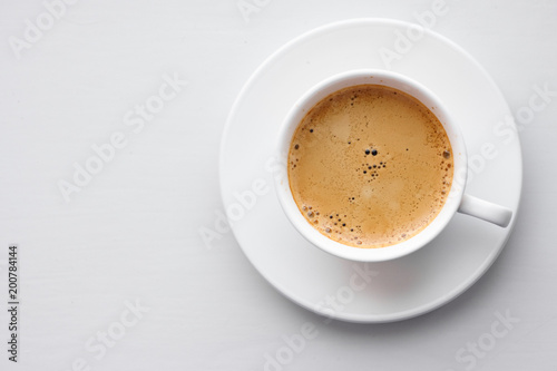 Fotografia Coffee cup on saucer on white background