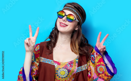 Fotografie, Tablou Portrait of Young hippie girl with rainbow glasses on blue background