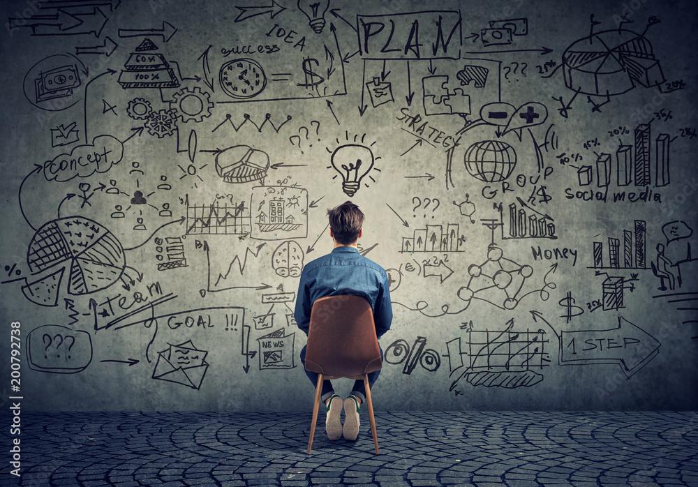 Fototapeta Man brainstorming on business plan