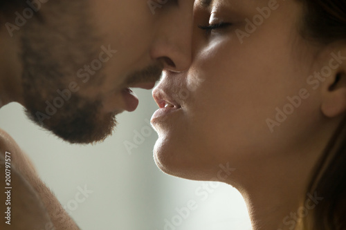 Sensual couple getting closer to feel each others lips, passionate affectionate Canvas-taulu