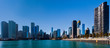 Wide Angle shot of Chicago Skyline with various skyscrapers with a blue sky on a sunny day