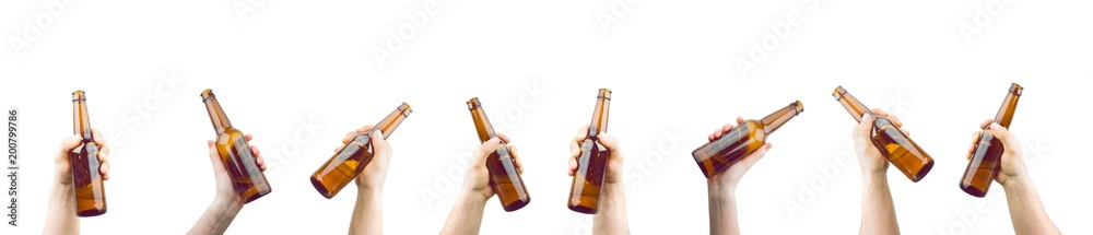 Fototapeta Bunch Of Hands Holding Bottles Of Beer Up At Party Giving A Cheers Isolated On White Background