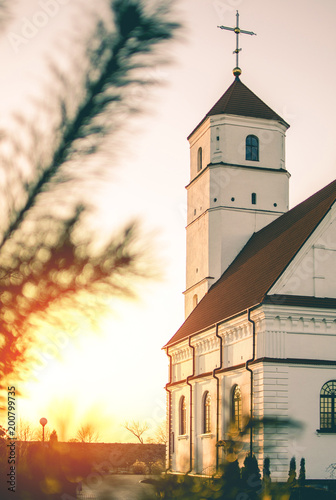 Church in front of spring sunset © Giddrid