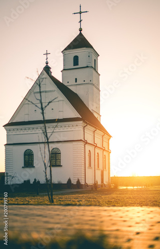 Church in front of sunset © Giddrid