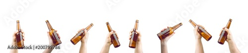 Spoed Foto op Canvas Bier / Cider Bunch Of Hands Holding Bottles Of Beer Up At Party Giving A Cheers Isolated On White Background