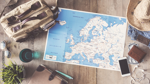 Travel concept on wooden background