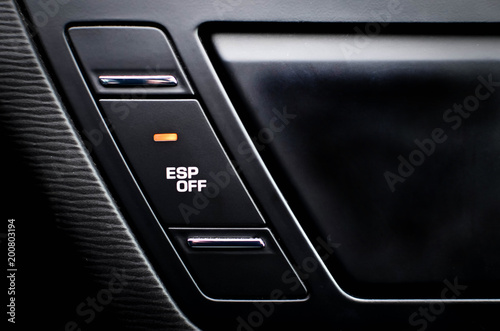 Fotografía  Close up inside car, button to disable traction control ESP