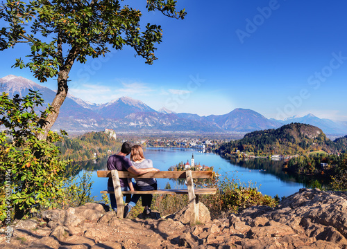 Photo  Couple in love looking at Bled Lake