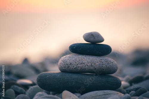 Zdjęcie XXL stack of zen stones on pebble beach