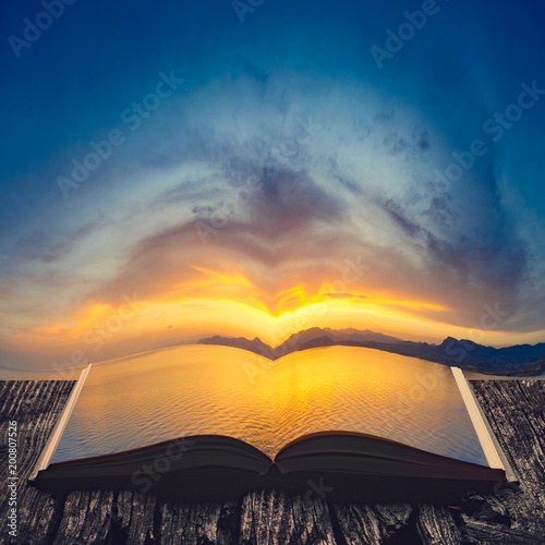 Sunset at the seaside on the pages of an open book