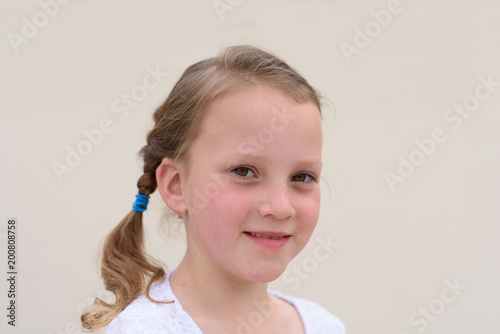 Fotografia, Obraz  Nice cute little girl with beautiful healthy freckle skin and long blonde  braided hair portrait