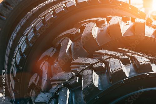 Carta da parati New modern black truck tire wheels in sunlight