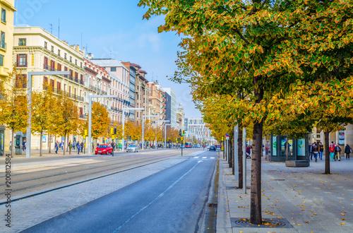 People are strolling through Paseo de la Independencia in Zaragoza, Spain