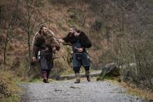 Two Viking Warriors Walk On An...