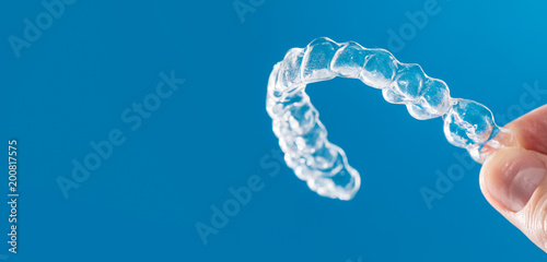 Photo  Inivisalign braces or invisible orthodontic aligner.