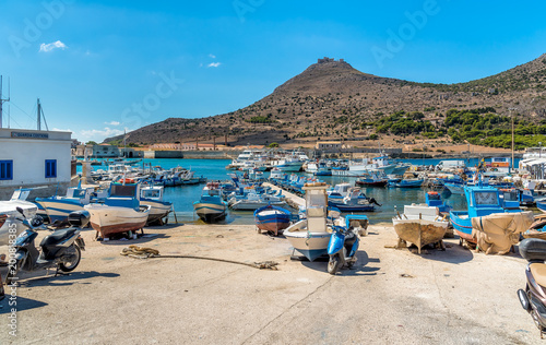 Foto auf Gartenposter Stadt am Wasser The Port of Favignana is the only port of the homonymous island, is the largest of the three Aegadian islands in the Mediterranean sea of Sicily.