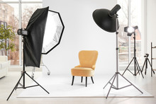 Armchair In Photo Studio With Professional Equipment