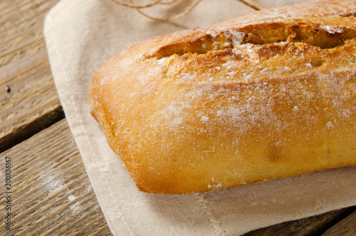 Ciabatta Bread On A Wooden Table Baking Paper Rustic Style Italian Background