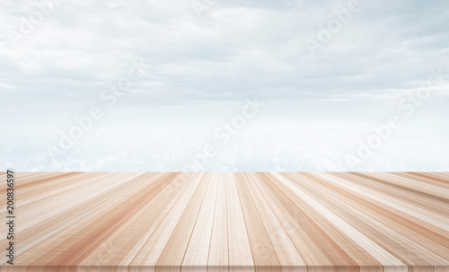 Design concept - Empty wood table top with cloudy sky