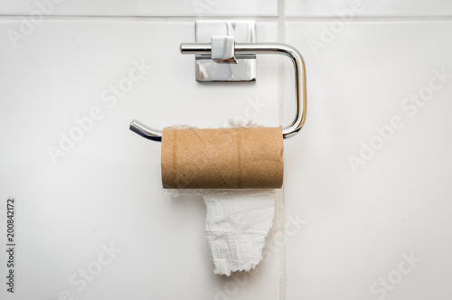 Fototapeta Empty toilet paper roll in public restroom