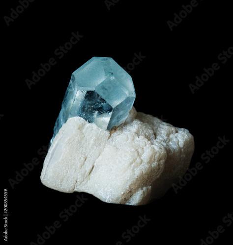 Photo Gemstone aquamarine  isolated on black