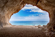 canvas print picture - cave at a lonely secret beach