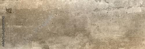 Obraz na plátně Textur einer XXL Betonwand, auf die etwas Sonnenlicht fällt als Hintergrund