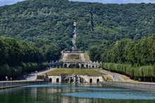 Caserta, Campania Region, Italy August 22 2016. The Splendid Royal Palace Of Caserta, With Its Three Kilometers Of Promenade Along The Fountains And Pools Adorned With Statues.