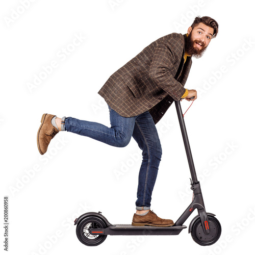 man holding the electric scooter and riding it while feeling delighted. image on white background Wall mural