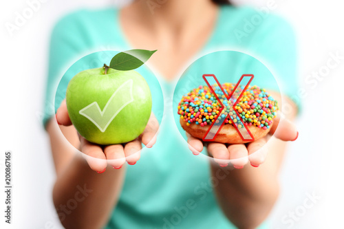 Healthy lifestyle concept, choose healthy fruits and not processed sweets