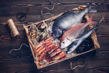 Fresh Spanish Fish And Seafood In Wooden Box On Wooden Table