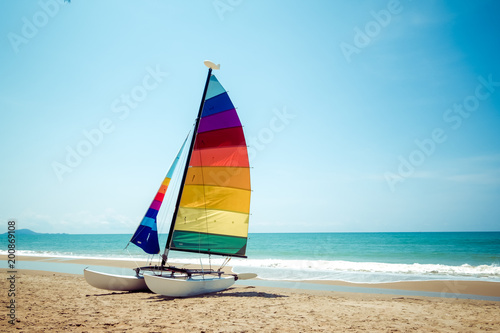 Colorful sailboat on tropical beach in summer. Fototapeta