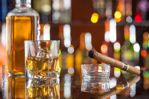 Vászonkép  Whiskey drinks on bar counter.