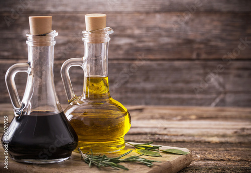olive oil and balsamic vinegar on a wooden background