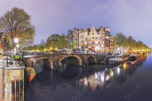 Photo  Canals of Amsterdam. Moody night panorama of Rossebuurt district