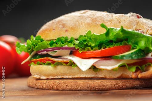 Foto op Canvas Snack sandwich on a wooden table