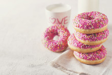 Stack Of Pink And White Donats...