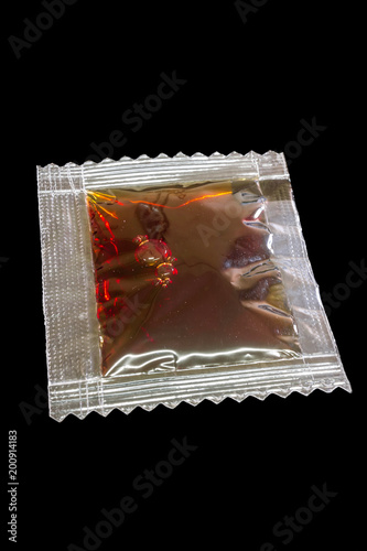 soy sauce in package isolated on black background