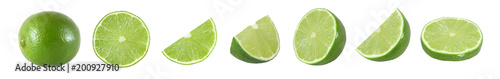 Valokuvatapetti Collection of whole and cut lime fruits isolated on white background with clippi