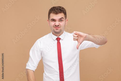 Fotografie, Obraz  Businessman showing dislike sign
